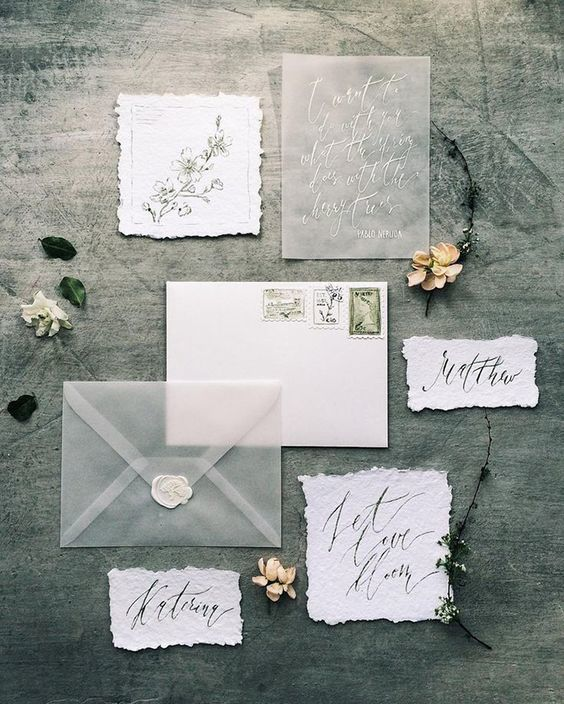 Hand Lettered Wedding Invitation Inspiration   Vellum envelopes stole the show for this gray wedding invitation suite. The bride used paper with rough edges and a white wax seal for a look that is unique and elegant. With a detail like this, guests will be impressed with your eclectic choice in wedding invitations.