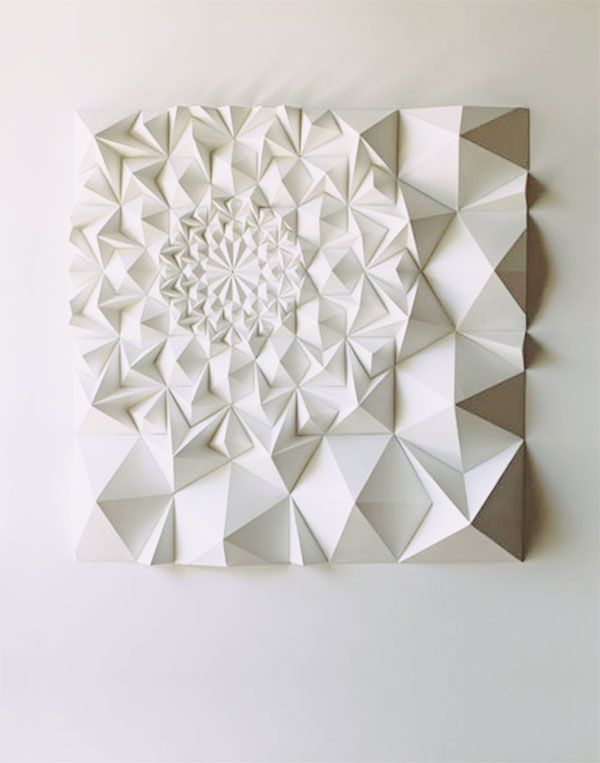 This is a fantastic example of an incredible sculpture made with simple materials. This sculpture is made entirely of paper, but it is 3D and looks solid, as though it could be made of marble. It is pristinely white, and looks clean which is very evocative.