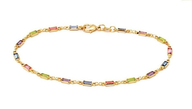 Multi-Coloured Anklet Stunning Multicoloured Anklet will add glamour to your summer look      Wear with heels, sandals or barefoot      Features 17 sparkling baguette-style cut crystals      Crytals are all different colours      Crystals embedded in an 18ct gold plated chain      Features a lobster claw clasp      Anklet measures 10 inches long; adjustable to fit      Save 85% on...