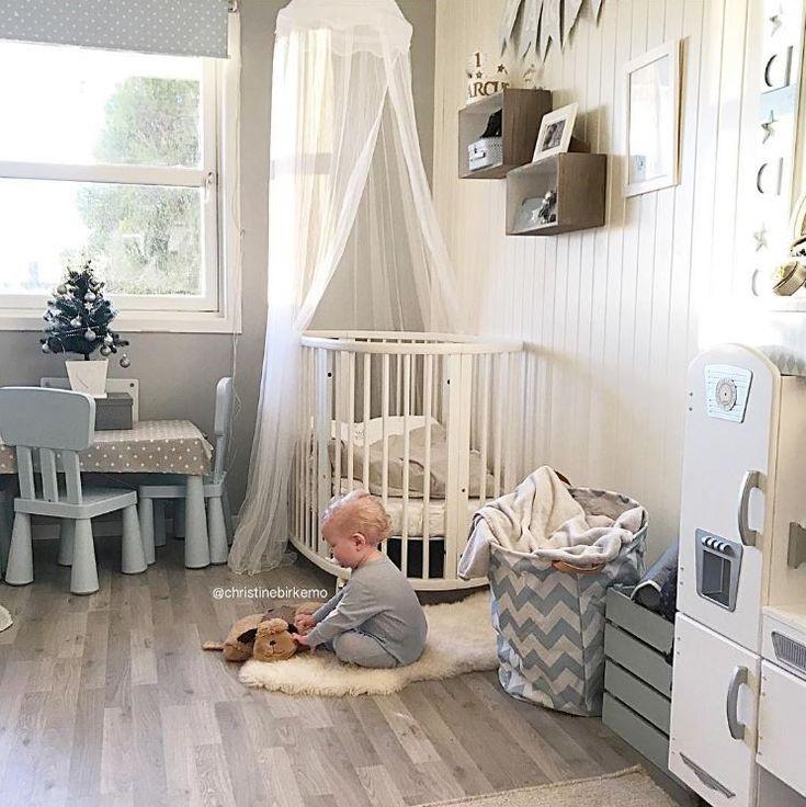 White and Gray Nursery with White Stokke Sleepi Crib and Canopy