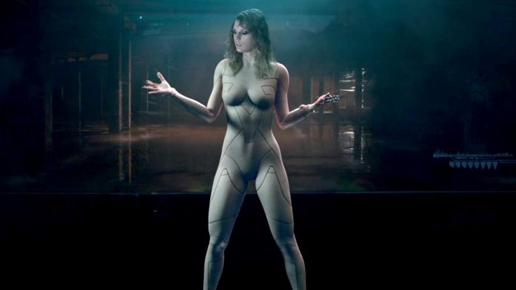 """Taylor Swift fans have drawn plenty of theories out ofthe teaser for her upcoming music video for """"...Ready For It?"""". One of the most popular is around the costume she wears in the clip: she appears to be wearing a nude bodysuit. Many fans think this alludes to Kanye West's video for """"Famous"""" where he featured a naked wax model of the pop star. West's track included the controversial lyric: """"I feel like me and Taylor might still have sex."""""""