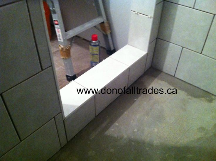This Unique Shower project included the installation of backer board, dry pack for the floor, 8x10 ceramic tile, glass inlay, 12x12 tile sheets for the floor, sanded grout with polymer for grouting vinyl tiling  edge to give the entrance a clean uniformed look and more!