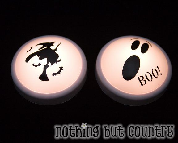 Halloween: Dollar Store Push lights with Halloween themed stickers.