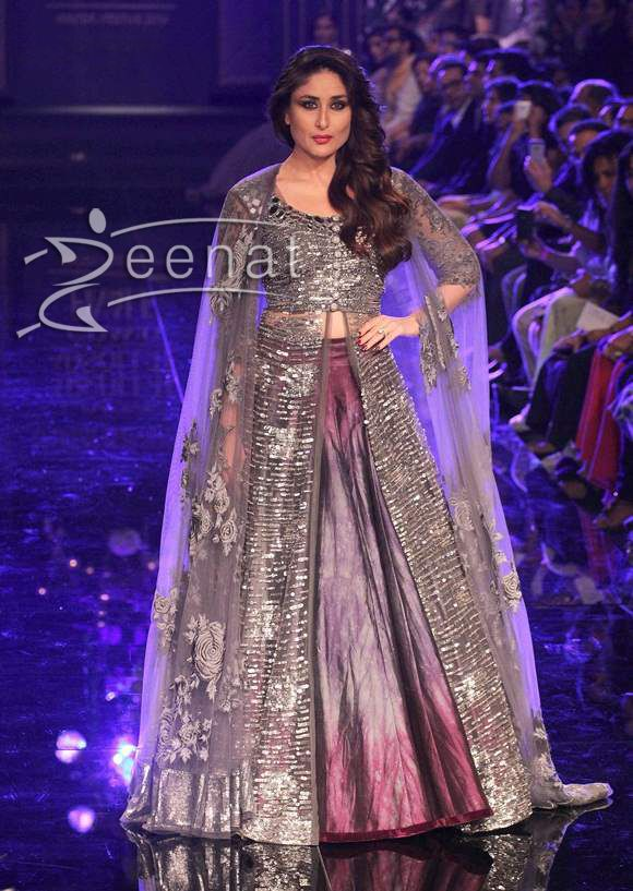 Bollywood actress Kareena Kapoor looked classy and elegant as the showstopper in designer Manish Malhotra's creation.She looked very comfortable in an embellished metallic purple lehenga with grey shades