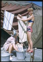 Charles W Cushman photo collection  Two Alzanas hang out their wash. Ringling Circus Chicago