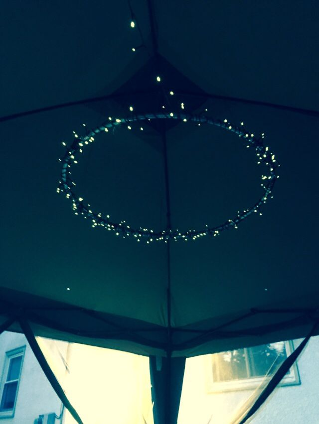 Hula hoop and solar powered fairy lights= perfect solution for mood lighting in the gazebo! Only took be a few minutes to whip up, and I hung it with twine.