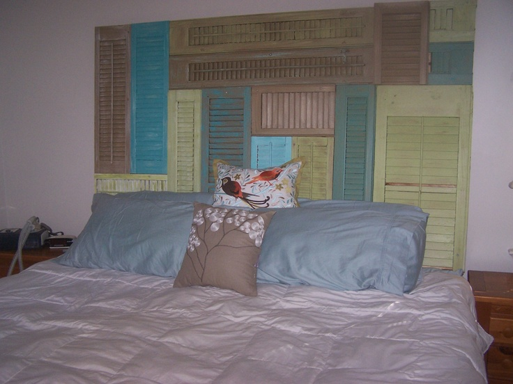 rental decorating idea:  headboard made from old wood shutters that I painted and attached to plywood with screws. Easy to move to our next place and adds the pop of color I want in my room.