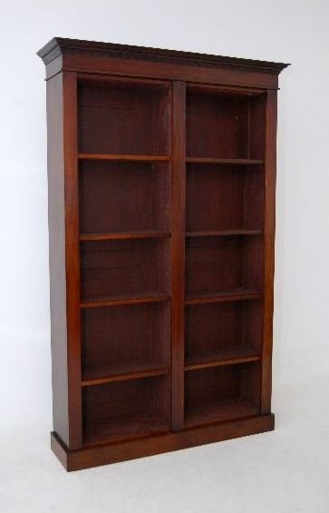 Large antique mahogany open bookcase has been reconstructed from very old timbers. Two separate compartments each with adjustable pine shelves, faced off in mahogany. In the corners are 'shark tooth' supports, just like the Victorian ones. The top cornice just lifts off, the middle separates into two sections, which lift off the plinth. This is a very practicable piece of furniture & will hold a lot of books. This bookcase has been hand 'French Polished' & so has a nice overall character.