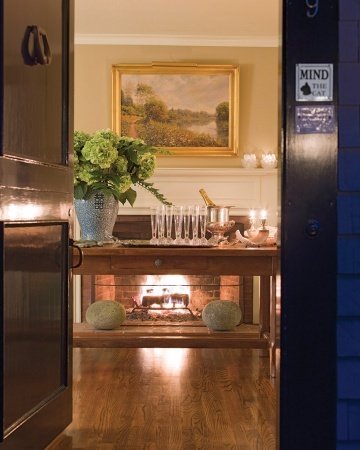 for parties - DIY bar on farm table in front of foyer fireplace