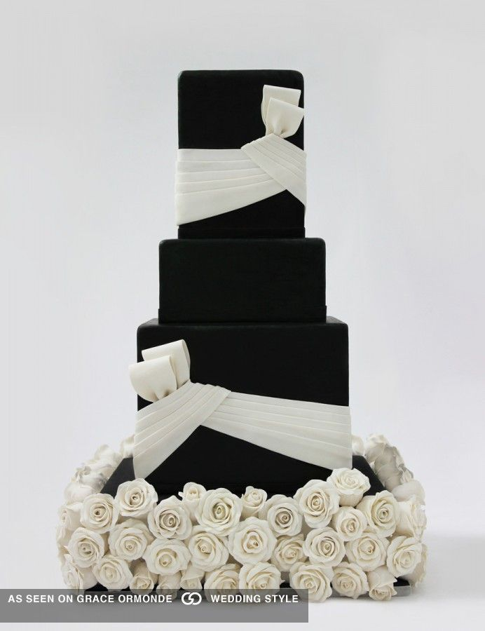 Black fondant cake with white bows and