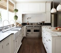 donna: kitchens - Sloane Single Pendant topiaries subway tiles backsplash pot filler creamy white kitchen cabinets farmhouse sinks black marble by ursula
