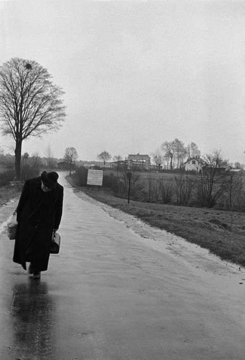 """""""Before the building of the Berlin Wall, an elderly woman leaves the Soviet Sector of Berlin, carrying her meagre possessions.  West Germany, 1951  byErich Lessing"""""""