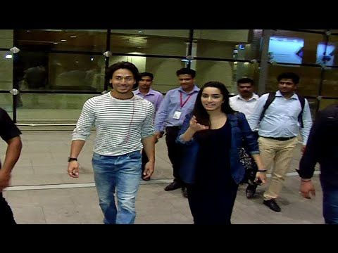Tiger Shroff & Shraddha Kapoor at Mumbai Airport returning back from BAAGHI movie promotions.