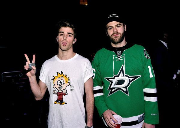 Andrew Taggart Photos Photos - Recording artists Andrew Taggart (L) and Alex Pall of music group The Chainsmokers pose backstage during 106.1 KISS FM's Jingle Ball 2016 presented by Capital One at American Airlines Center on November 29, 2016 in Dallas, Texas. - 106.1 KISS FM's Jingle Ball 2016 - Show