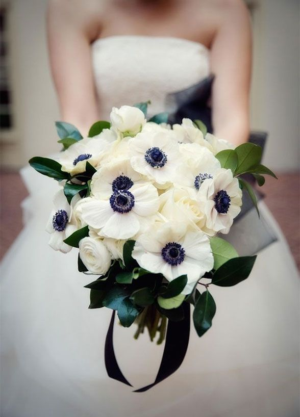 A bouquet of anemone flowers embodies the crisp and clean feel of the season. Winter wedding bouquet ideas