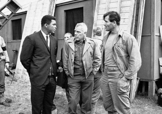 "Muhammad Ali visits the film set of ""The Dirty Dozen"" in Great Britain in 1966, meeting with stars Lee Marvin, center and Clint Walker. Description from militarytimes.com. I searched for this on bing.com/images"