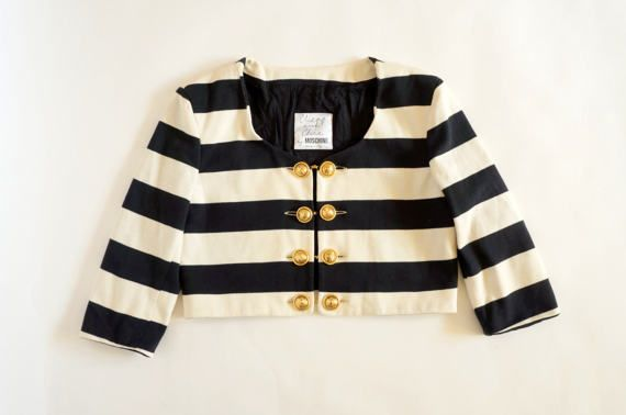 Hello Im glad youre here PANDORA FASHION shop  I offer vintage MOSCHINO CHAEP & CHIC jacket Made in Italy color: black/white stripes gold buttons with chain  100% cotton  size on tag I48 USA14 F44 GB16 D44 used in very good condition   total length 42 cm/16,54 inch width shoulders 45 cm/17,72 inch width armpit to armpit 51 cm/20,08 inch length sleeves 45 cm/ 17,72 inch length sleeves from armpit 28 cm/11,02 inch   If you have any question write to me  More ph...