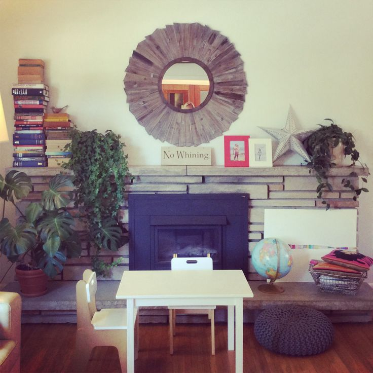 Our living room. This is the most used room in our house. My favorite piece is the barn board mirror over the fireplace. I also think every room should have some books in it (along with plants)!