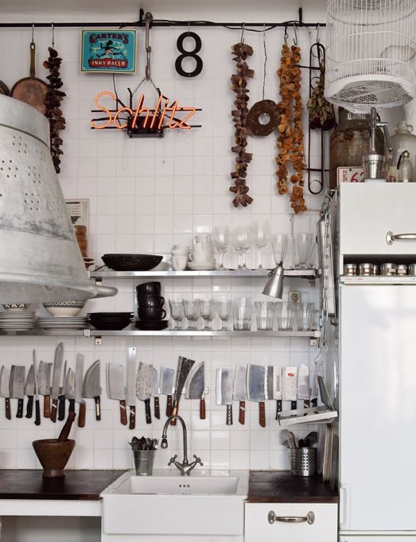 sexy set of knives.    B L O O D A N D C H A M P A G N E . C O M: apron sink, subway tile, white fridge, wood countertop