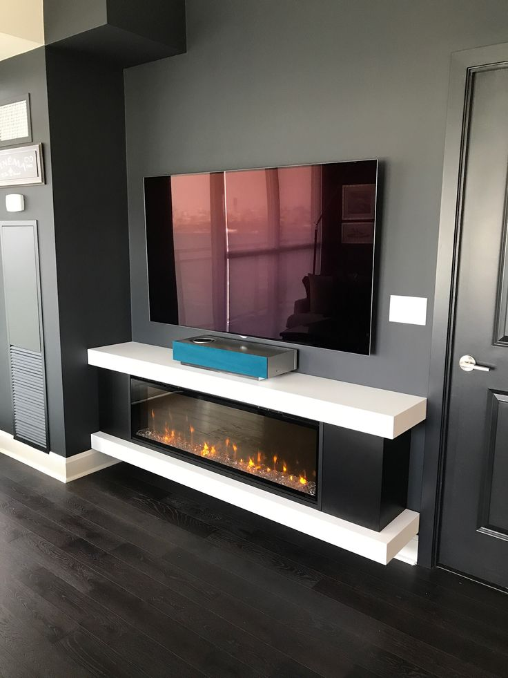 Custom Cabinet with a regular Electric Fireplace. Private Residence Toronto. Fireplace with TV above.