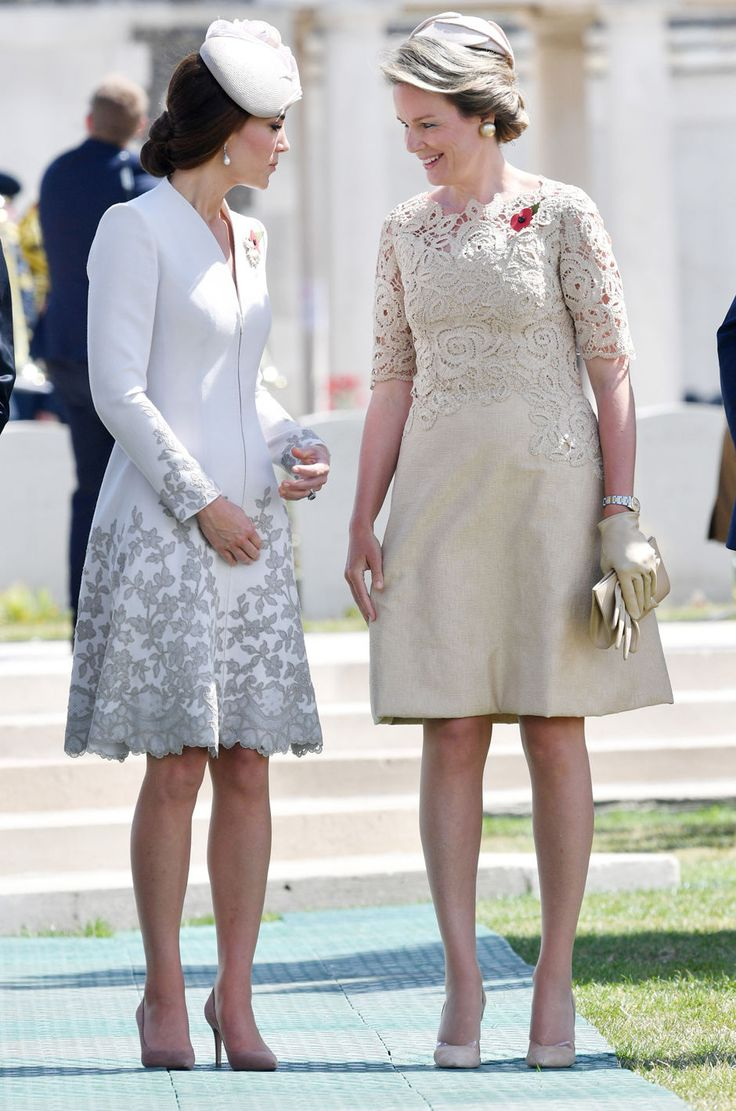 Queen Mathilde of Belgium chats with Catherine, Duchess of Cambridge during commemorations at the Tyne Cot Commonwealth War Graves Cemetery on July 31, 2017 in Ypres, Belgium. The commemorations mark the centenary of Passchendaele - The Third Battle of Ypres.