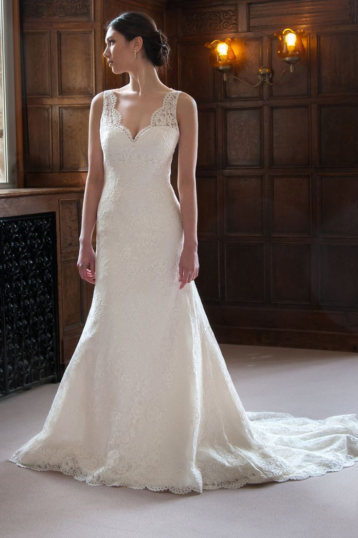Daphne: Daphne features the most flattering relaxed fit & flair silhouette. Details include a delightfully pretty V neckline with a scallop lace trim.  But the surprise comes when the bride turns around, revealing a gorgeous open keyhole back. A contemporary wedding gown that has grace and style.