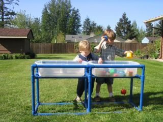 Make your own- PVC Piping sensory water table.  What a great, low-cost idea for an outdoor sensory tub/table!
