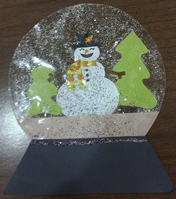 Make your own snowglobe craft...Use construction paper to create what you want inside your snowglobe. Cut two large circles out of clear contact paper. Place insides on bottom contact, sprinkle glitter, and place top contact on top. Staple on construction paper base and put a line of glitter over the staples.