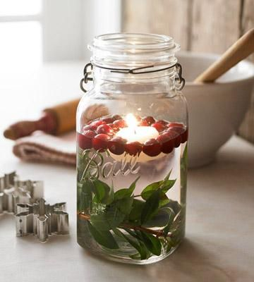 So pretty for the kitchen counter or holiday table! Fill a canning jar 2/3 full of water, drop in a sprig of greenery and a few fresh cranberries, and add a floating candle. | Living the Country Life | http://www.livingthecountrylife.com/country-life/decorating-for-a-country-christmas/