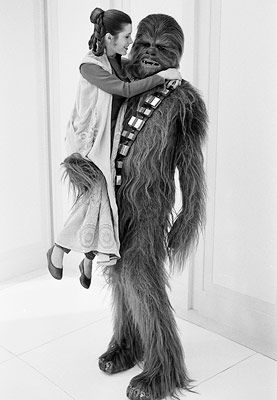 Carrie Fisher and Chewbacca (Peter Mayhew) live it up in Cloud City