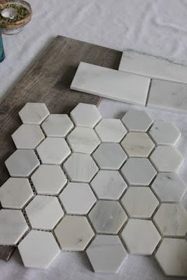 "The shower floor will be finished in 2"" Hampton Carrara Polished Hex. The shower walls will be 3X6"" Hampton Carrara Polished subway tiles. Bayur Borneo ceramic floor tile looks like weathered wood."