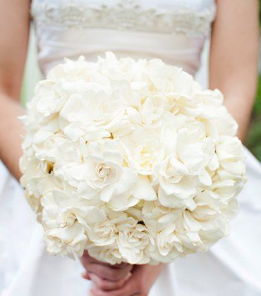 An all gardenia bouquet. Over 50 wired gardenias! Stunning bouquet by The Flower Factory on http://WedOverHeels.com | Photo by http://alanacouch.com