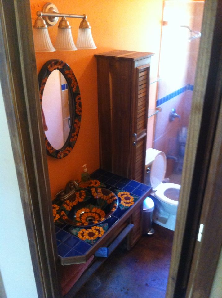 Bathroom vanity and armoire. Teak and tile