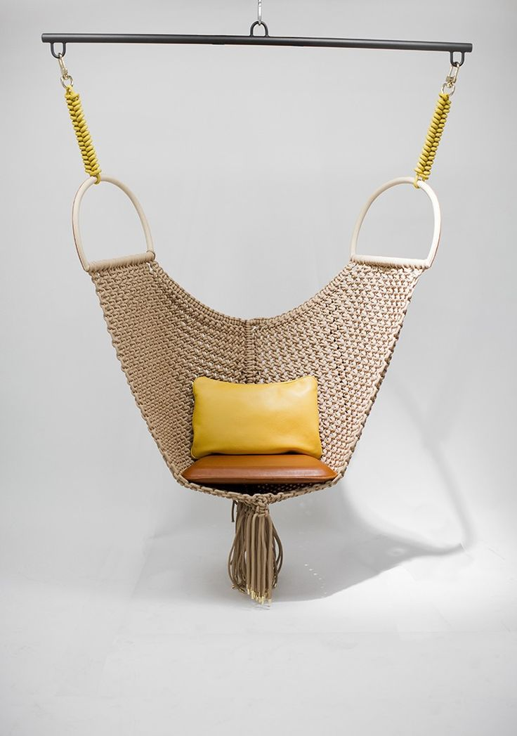 This leather swingchair formed part of a collection of leather goods created by independent designers for Louis Vuitton