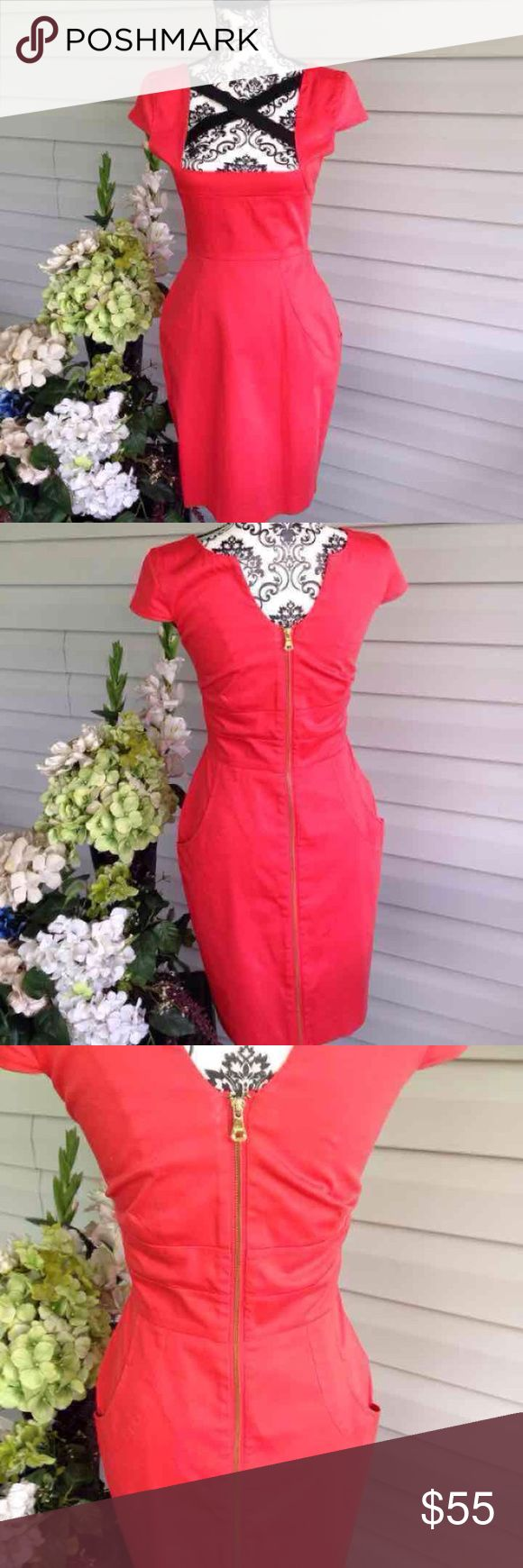 Guess Fire Engine Red Cross Over Back Zipper Dress Guess. Zip up front. Cross cross straps in back. Pockets in front. Knee-midi length (depending on your height) high end quality. No known flaws. Red and black. Free gift. Size 4 Guess Dresses Midi