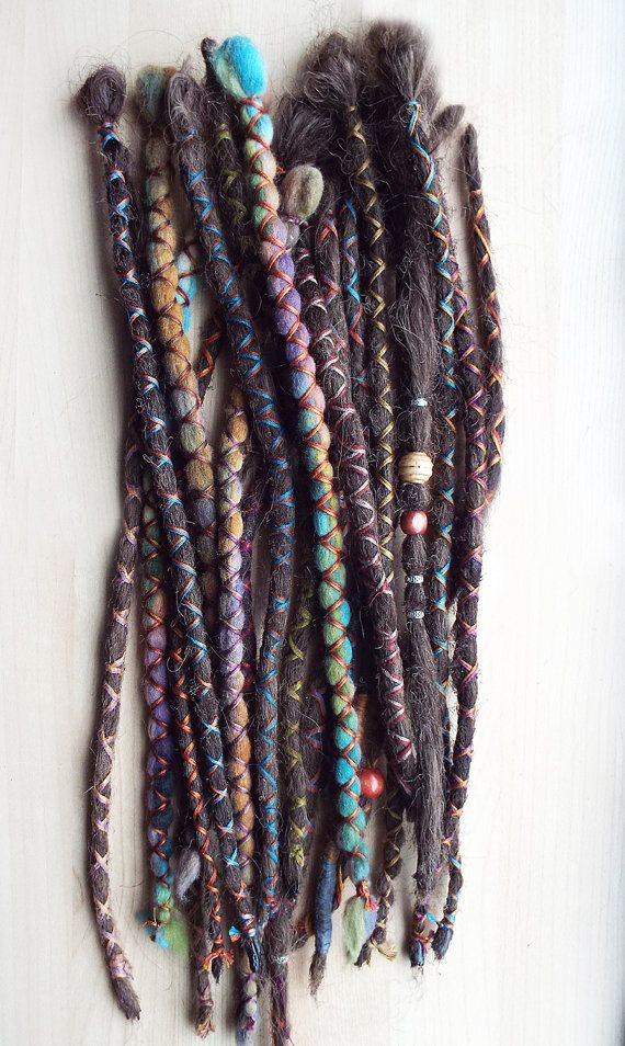 Synthetic hair removable dreadlock extensions by Purple Finch! 10 Custom X-Cross Wraps. Dreadlocks are made to order. This set includes 2 x-cross wrapped tie-dye wool dreads 1x plain dread with 3 silver