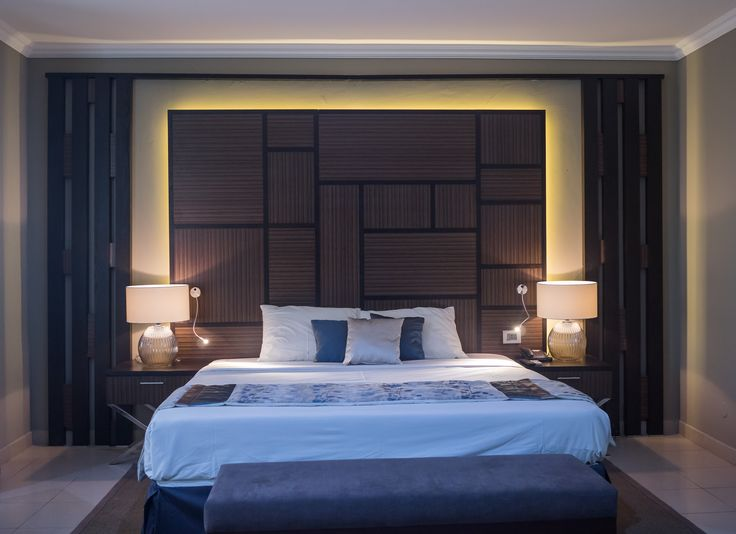 Bold earthy colours and a mix of sizes coupled with a sublime lighting effect create an impressive executive room in a hotel