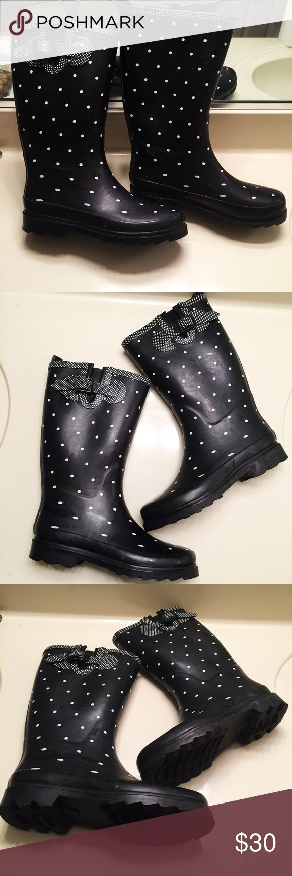 Black and white polka dot rain boots size 9 Black and white rubber polka dot rain boots women's size 9. Have been worn once but are in excellent condition Shoes Winter & Rain Boots