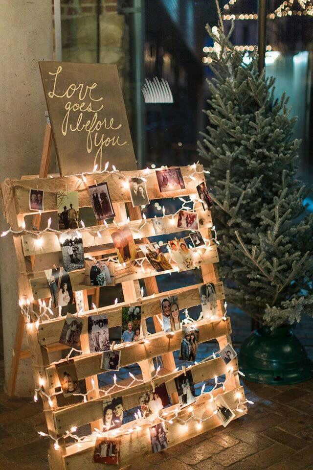 "I wanted to do something special for our daughters wedding. I displayed wedding/marriage pics from both sides of the family. I had vintage, as well as modern pics. The wedding was a rustic-boho theme in winter, so the display was a wooden pallet, tied to a wooden ladder to provide a large easel. We added twine, lights & clothes pins to attach the pictures. Topped it off with a canvas that said ""Love goes before you""."