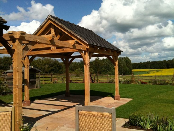New, bespoke oak gazebo & pergola to provide shade in what is a very exposed garden & a lovely place to relax or entertain.