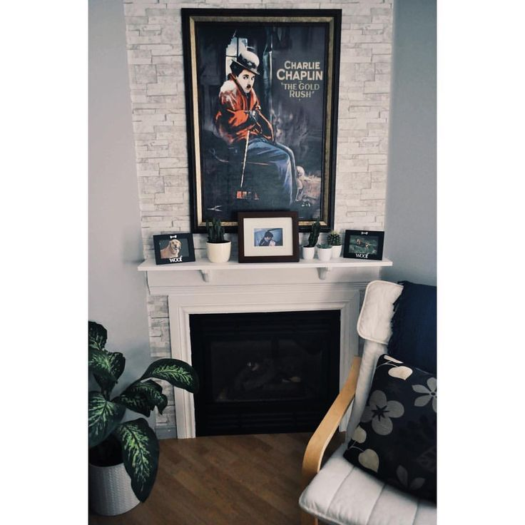 Cozy place to read good books 📚 Faux fireplace with faux brick wall  (@daphiidesings)