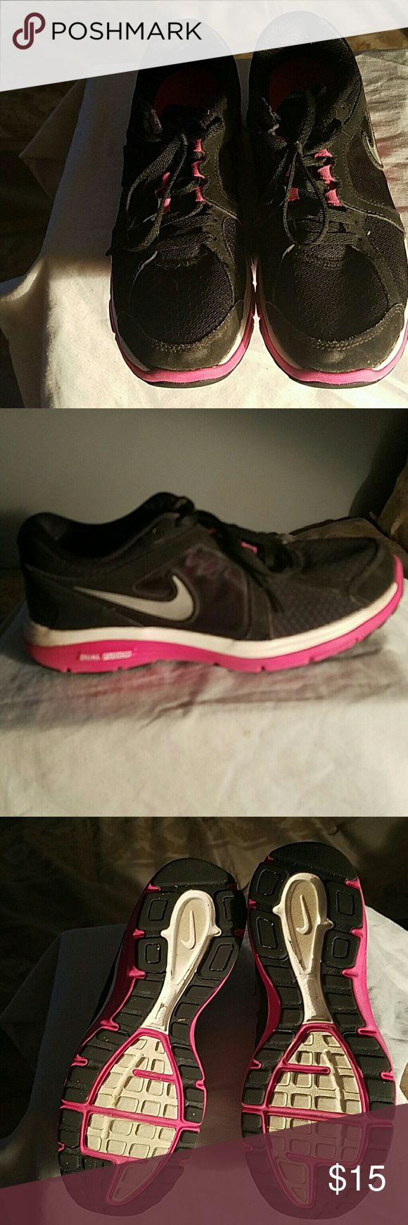 Nike Dual Fusion Sneakers Nike Dual Fusion Sneakers. Size 7 1/2.  In very good used condition, not worn many times at all. Great color mix...Black and Pink with silver swoosh on sides. No Box. Excellent pair of Nike Sneakers at incredible price!! Nike Shoes Sneakers