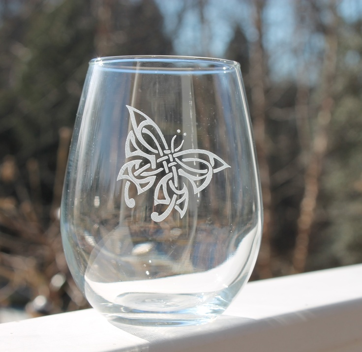 Custom etched Butterfly stemless wine glass.These etched stemless wine glasses are perfect for any occasion. Holds 12oz. This image can be etched on any of our glassware. All of our glassware is sandblasted and handmade by us in our studio. Sandblasting is a technique used to engrave on many different surfaces such as stone, glass, wood, and metal. We do not use any chemicals to etch our glassware.