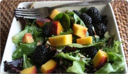 mixed green salad with peaches & blackberries in champagne vinaigrette.