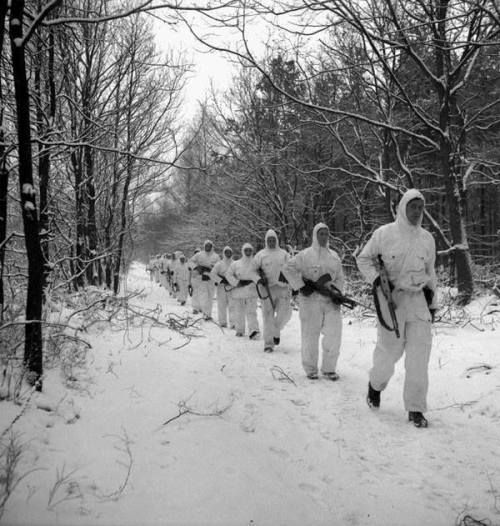 Infantrymen of The Queen's Own Rifles of Canada, who are wearing British winter camouflage clothing, on patrol near Nijmegen, Netherlands, 22 January 1945. http://wrhstol.com/2xX8lhV