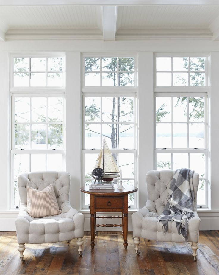 floor to ceiling windows + tufted chairs