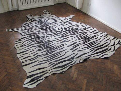 Cowhide Rug White Tiger Furniture Pinterest Cowhide Rugs Shops And Rugs