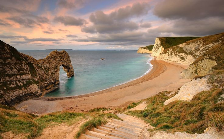 Durdle Door Beach, Dorset, England. Durdle Door is the limestone arch that's appeared in Beyond the Sea, Far From the Madding Crowd & the music video for Tears for Fears' Shout, among others. Take a hike on the pebble beach..