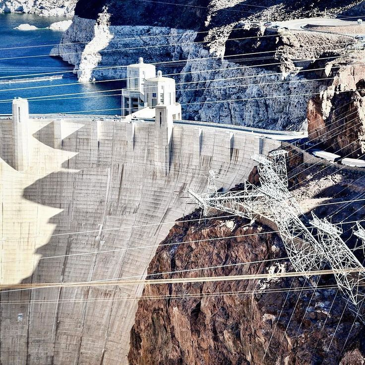 What a marvelous sight. The #hooverdam from the Mike OCallaghan-Pat Tillmon Memorial Bridge. What attracted me to this photo were the #geometric lines  of the #powerlines and structure comprising the #electrical #grid. #hydroelectric #dam #watermanagement #coloradoriver #lakemeade #travelgram #westernusa