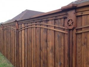 Custom Cedar Privacy Fence with Top Cap, double side trim, arched trim, & custom corbels.
